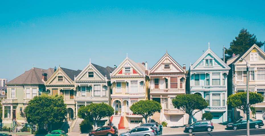 A row of colorful Victorian houses.