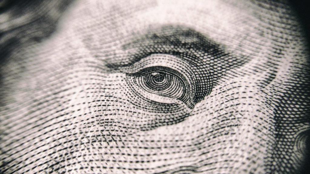 a closeup of an eye from a $100 bill
